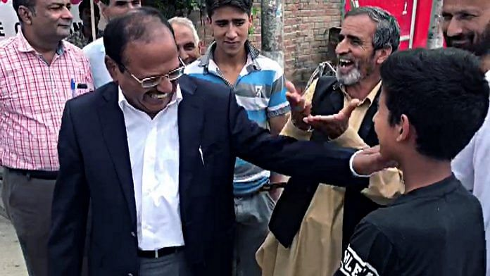 NSA Ajit Doval interacts with a boy during his visit to Anantnag on Saturday   Photo: ANI