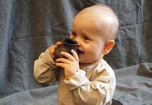 A baby testing a replica of one of the ancient bottles. | Helena Seidl da Fonseca, Author provided