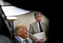 U.S. President Donald Trump, left, speaks as John Bolton, national security adviser, listens during a meeting. | Photographer: Andrew Harrer | Bloomberg