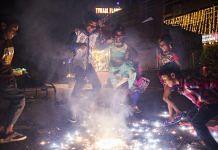 Children set off a firework during Diwali celebrations in Delhi | Photographer: Prashanth Vishwanathan | Bloomberg