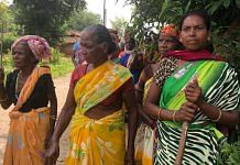 Women blocking the entry to Suari village in Jharkhand's Khunti district. Photo: Madhuparna Das/ThePrint