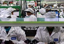 Employees test mobile phones on an assembly line in the mobile phone plant of Rising Stars Mobile India Pvt., a unit of Foxconn Technology Co., in Tamil Nadu | Karen Dias/Bloomberg