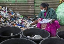 A worker sorts plastic household waste at a warehouse in a recycling facility operated by Mysuru City Corp. in Mysuru, Karnataka, India. | Photo: Samyukta Lakshmi | Bloomberg