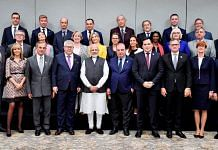 Prime Minister Narendra Modi poses for a photograph with the members of European Parliament | PTI