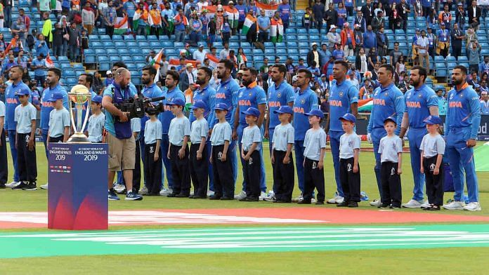 Indian cricket team standing for the national anthem during the World Cup