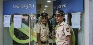 Police personnel stand guard outside Punjab and Maharashtra Cooperative Bank (PMC) at GTB Nagar in Mumbai | PTI file photo