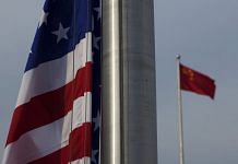 The US flag is seen next to the Chinese Flag in Beijing