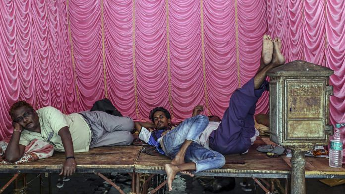 People rest on a temporary stage in Mumbai, India   Representational image   Dhiraj Singh/Bloomberg