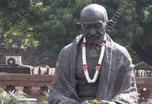 Mahatama Gandhi's statue, at Parliament, adorned with flowers on occasion of his 150th birth anniversary | Praveen Jain | ThePrint