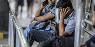 People browse their mobile phones in Mumbai (representational image)| Photographer: Dhiraj Singh | Bloomberg