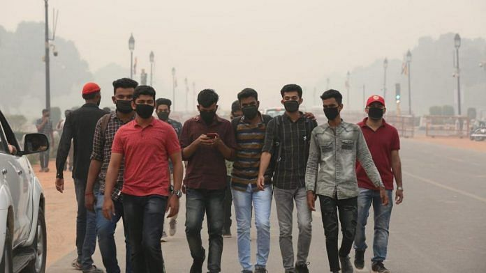 People wear face masks to protect against the severely bad air quality in Delhi. Pollution levels spiked to alarming levels after Diwali, with the EPCA declaring a public health emergency | Suraj Singh Bish | ThePrint