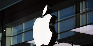 An Apple inc. logo is displayed at their store at Yorkdale mall in Toronto | Photographer: Brent Lewin | Bloomberg