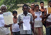 People show their documents as their names weren't included from the NRC