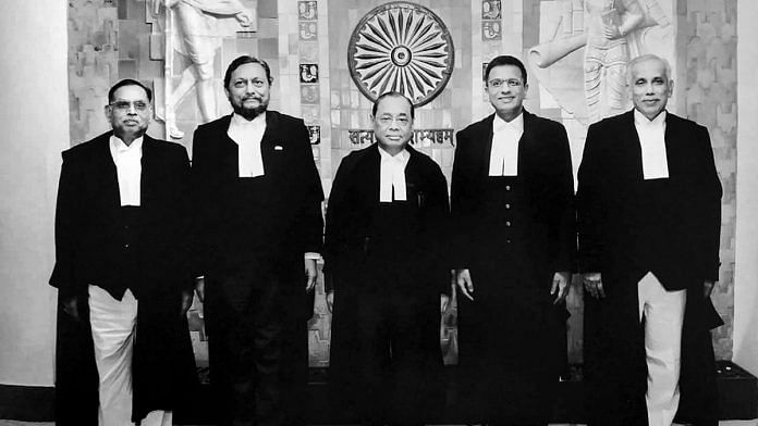 A group photo of the five-judge bench comprised of Chief Justice of India Ranjan Gogoi (C) flanked by (L-R) Justice Ashok Bhushan, Justice Sharad Arvind Bobde, Justice Dhananjaya Y Chandrachud, Justice S Abdul Nazeer after delivering the verdict on Ayodhya land case, at Supreme Court in New Delhi on 9 Nov 2019 | Photo: PTI