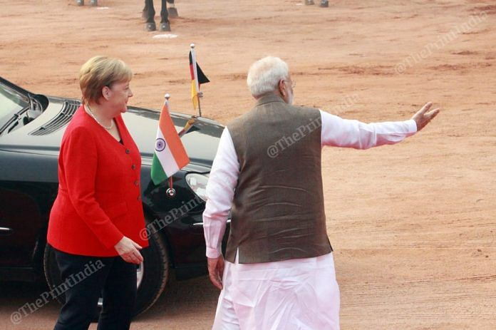 Prime Minister Narendra Modi with German Chancellor Angela Merkel. This is the fifth meeting between the two leaders this year | Photo: Praveen Jain | ThePrint