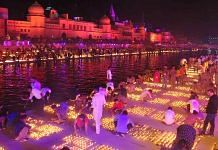 People light earthen lamps on the banks of Saryu during Deepotsav celebrations, in Ayodhya Saturday. | Photo: ANI