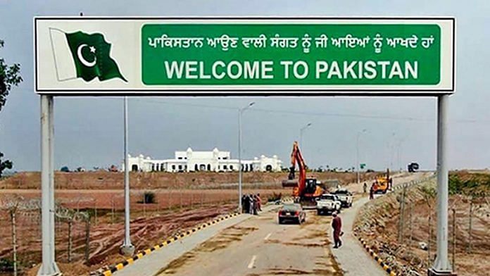 A sign board reads, ' Welcome to Pakistan', against the backdrop of Gurdwara Kartarpur Sahib in Pakistan. | File Photo | PTI