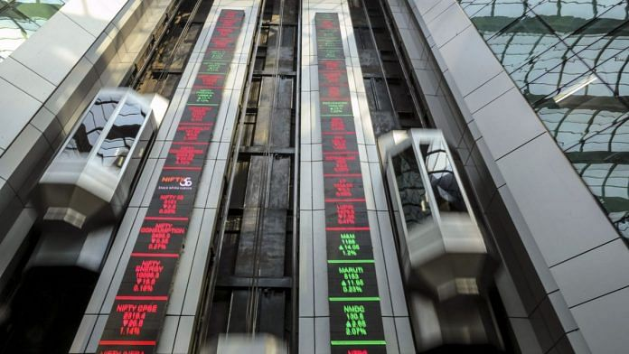 Electronic board indicates the latest stock figures at the the National Stock Exchange in Mumbai. | Photographer: Dhiraj Singh | Bloomberg
