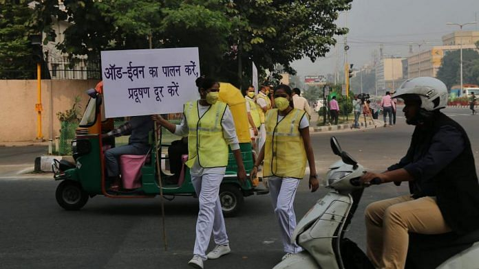 Volunteers hold placards reminding drivers to follow the odd-even rule in New Delhi. | Photo: Suraj Singh Bisht | ThePrint