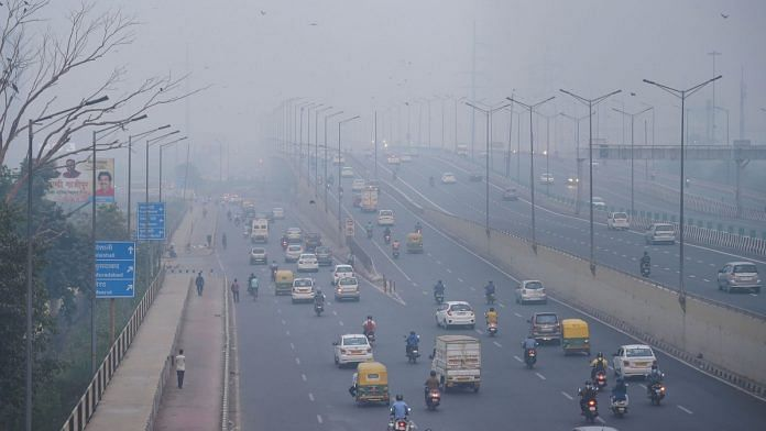 Vehicles ply amid an atmosphere shrouded in smog in New Delhi | PTI