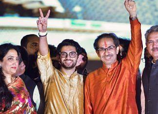 Newly sworn-in Chief Minister of Maharashtra Uddhav Thackeray, his son and Yuva Sena Chief Aaditya Thackeray acknowledge their supporters, at Shivaji Park in Mumbai. | PTI