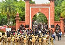 Police personnel stand guard outside Aligarh Muslim University as students protest against the passing of Citizenship Amendment Bill | PTI
