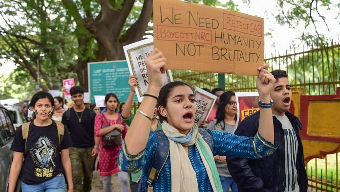Students raise slogans during a protest against police atrocity and Citizenship Amendment Act, in Bengaluru   PTI