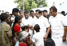 A file photo of Tamil Nadu Chief Minister K. Palaniswami and his deputy O. Panneerselvam meeting the families of those killed in the wall collapse in Coimbatore