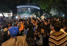 People protest outside the Delhi Police headquarters on Sunday night | ThePrint