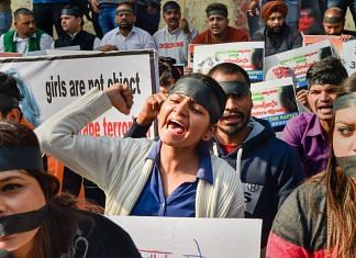 National Students' Union of India members raising slogans during a protest against the rape and brutal murder of a veterinarian in Hyderabad | PTI