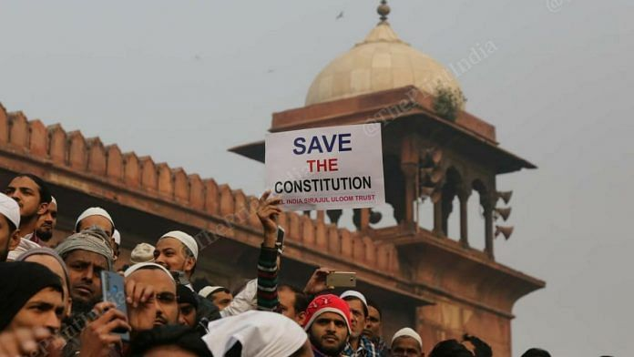 A man holds up a placard that reads 'Save the Constitution' at protest at Jama Masjid in New Delhi on 20 December 2019 | Suraj Singh Bisht | ThePrint Photo