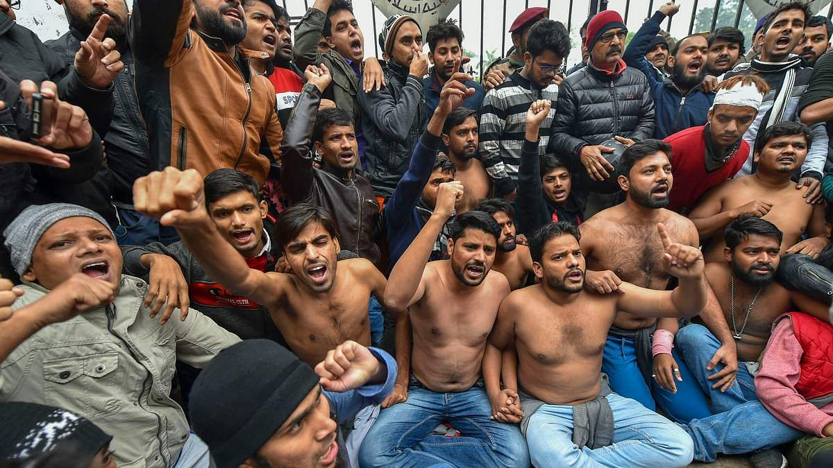 Students protest shirtless at the campus against Delhi Police's action on students at Jamia Millia Islamia
