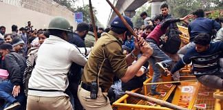 Police personnel baton charge on the students of Jamila Millia Islamia University as they started pelting stones