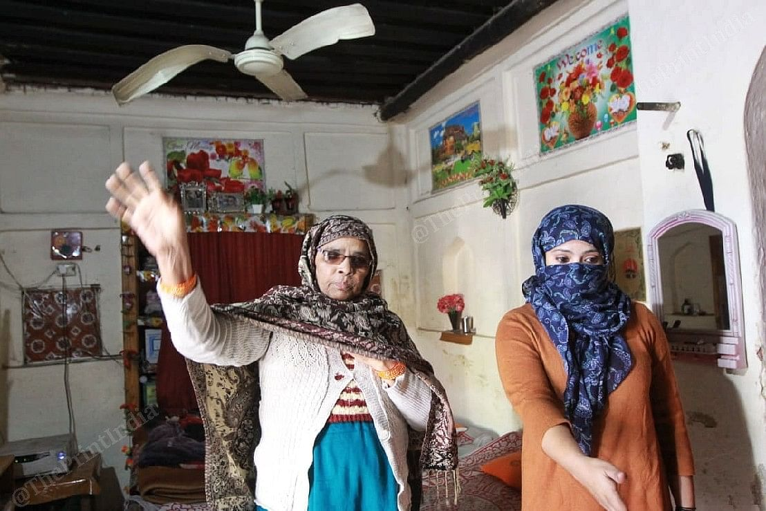 Mother and sister of Javed Ansari, who was arrested by the police, showing their 'vandalised' house | Photo: Praveen Jain | ThePrint