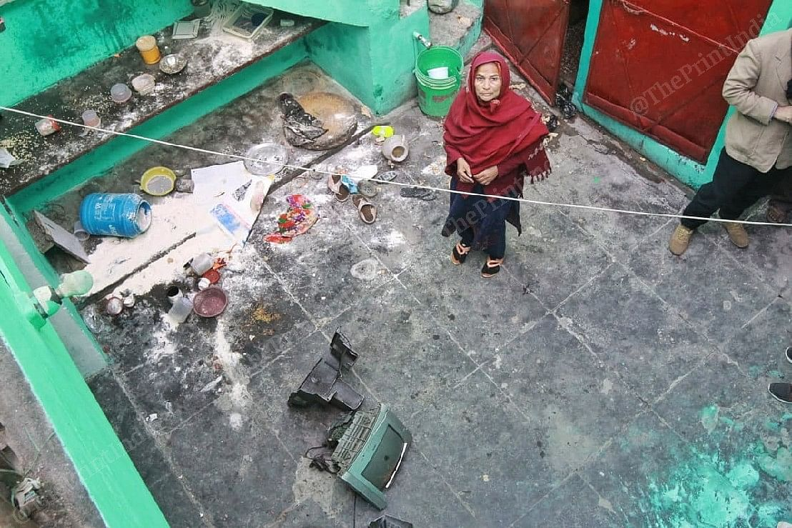 Zareena Khatoon shows the damage inflicted on her home as her son Qamar Ahmed was being arrested | Photo: Praveen Jain | ThePrint