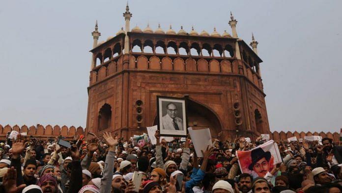The crowd at Jama Masjid protesting against Citizenship Amendment Act, holding the photo of BR Ambedkar | Photo: Manisha Mondal | ThePrint