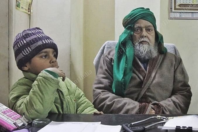 An old man with his grandson in Gorakhpur