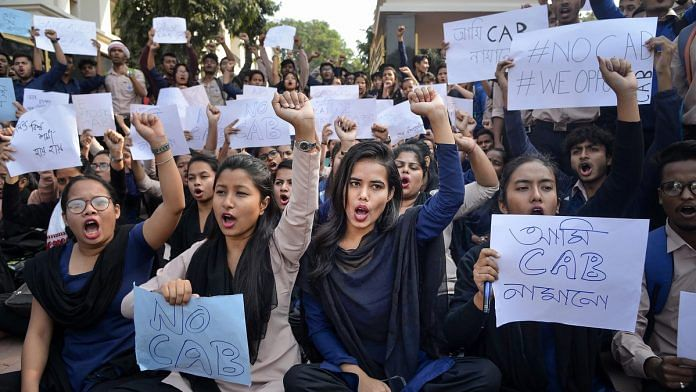 College students raise slogans in protest against the Citizenship Amendment Bill during a strike in Guwahati | PTI