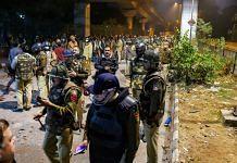 Policemen stand guard near Jamia Millia Islamia following the protests against Citizenship Amendment Act, in New Delhi, Sunday, Dec. 15, 2019. | PTI