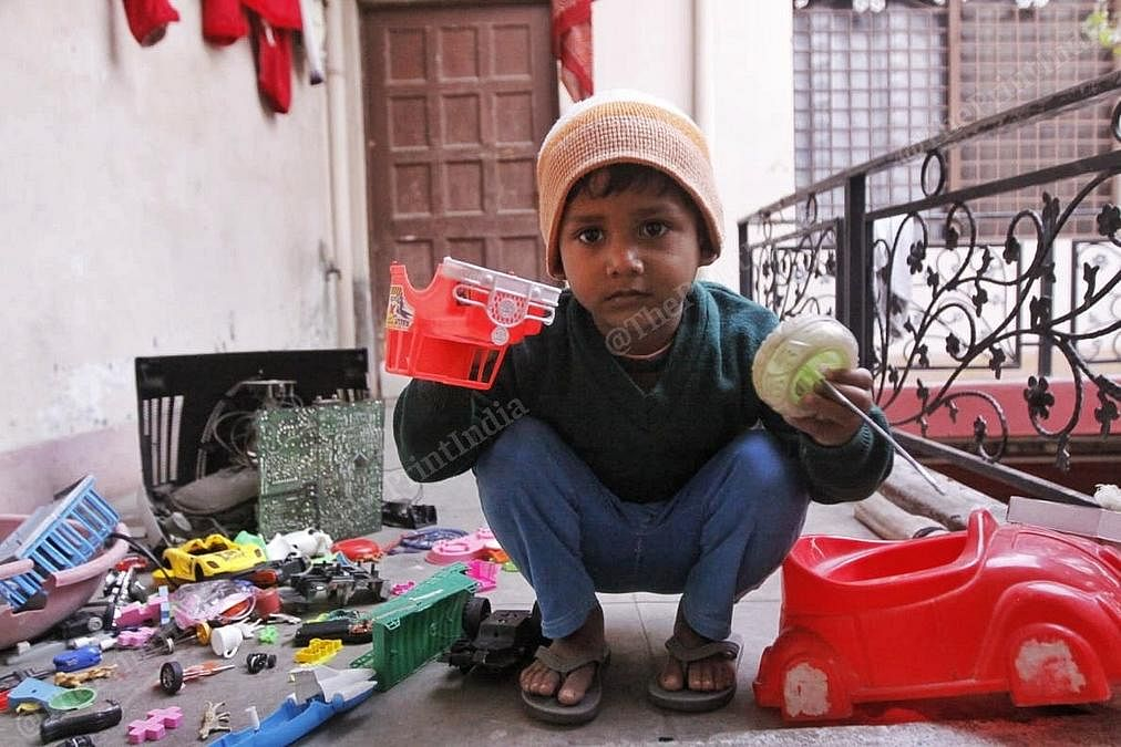 Razia Khatoon's grandson with broken toys. | Photo: Praveen Jain/ThePrint