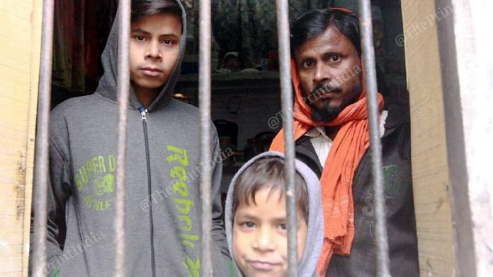 Mohammed Vakil, father of 8-year-old boy Sageer, with his other sons