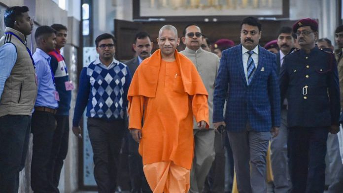 Uttar Pradesh Chief Minister Yogi Adityanath arrives to attend the Winter session of State Assembly in Lucknow | PTI