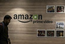 An employee walks past a Amazon Prime Video art wall at the Amazon Inc. campus in Hyderabad | Dhiraj Singh/Bloomberg