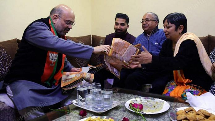 Shah visited homes in Lajpat Nagar and distributed literature on the amended CAA