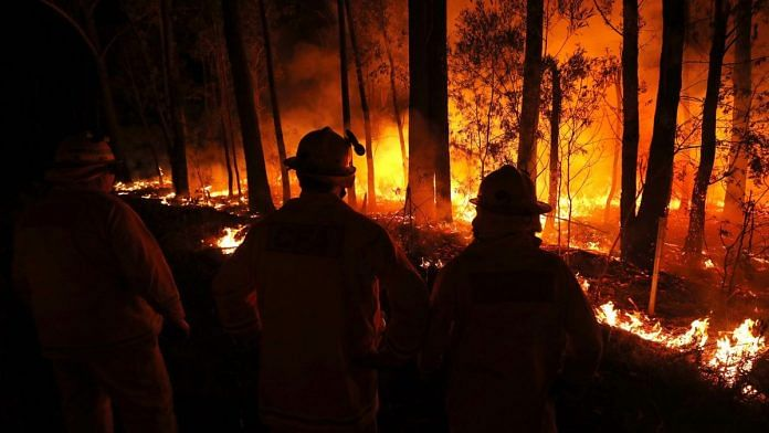 A wildfire burns between the towns of Orbost and Lakes Entrance in east Gipplsland on 2 January 2020 in Australia | Bloomberg