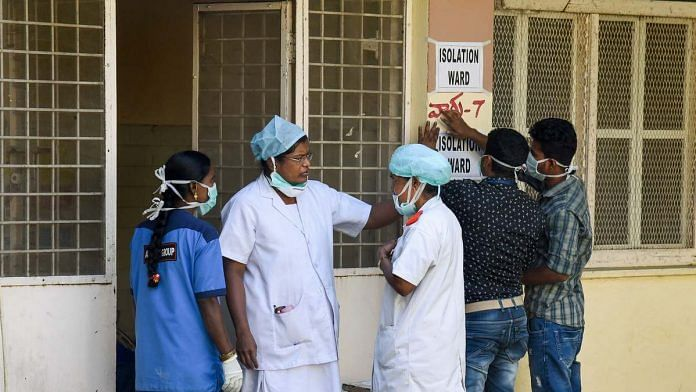 Hospital staff is seen outside the Special Isolation Ward set up for suspected cases of coronavirus in Hydebarad