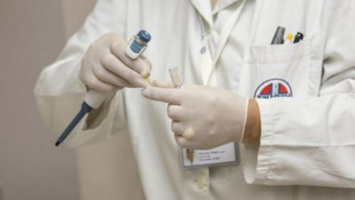 lab technician or doctor handles a test tube