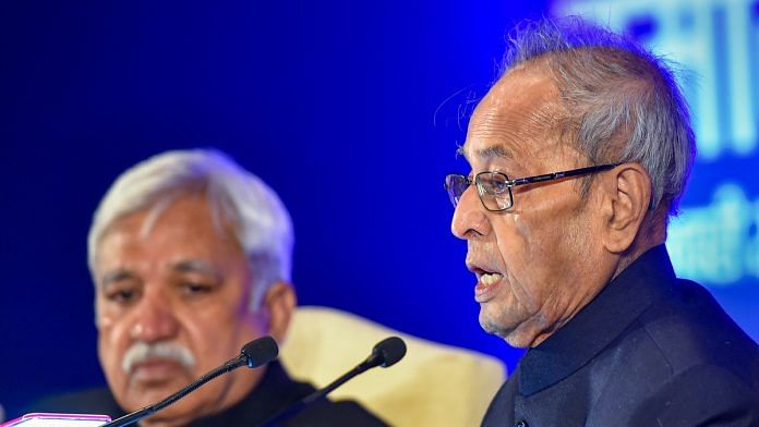 Former president Pranab Mukherjee (R) speaks as Chief Election Commissioner Sunil Arora looks on, during the first 'Sukumar Sen Memorial Lecture series', as part of tribute to India's first Chief Election Commissioner, at Pravasi Bhartiya Kendra in New Delhi, Thursday, Jan. 23, 2020.   PTI