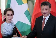 Chinese President Xi Jinping (R) shakes hand of Myanmar State Counsellor Aung San Suu Kyi during a meeting at the Great Hall of the People in Beijing on April 24, 2019 in Beijing, China. | Bloomberg