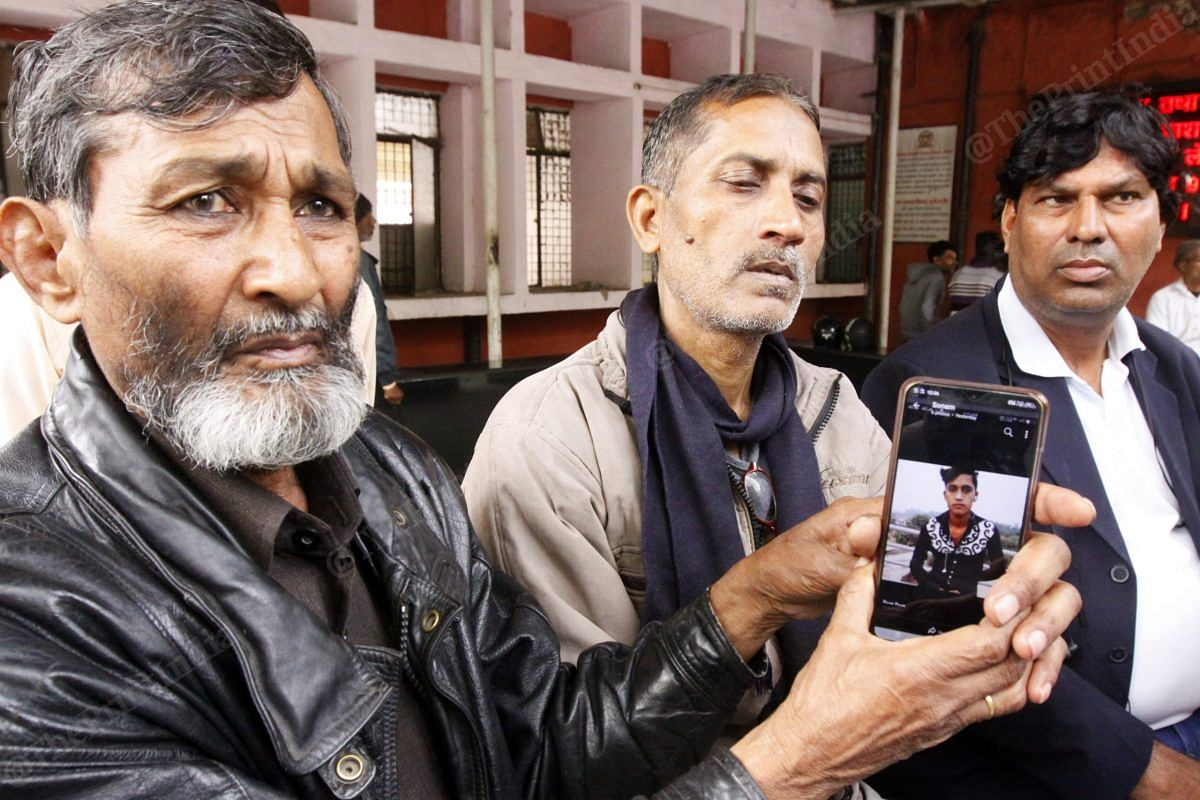 A relative of the two brothers shows Hashim's photo on his mobile phone at their residence at GTB hospital | Photo: Praveen Jain | ThePrint